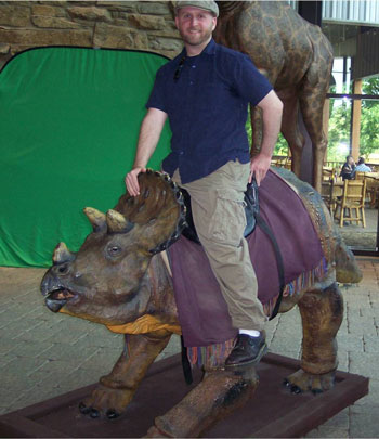 Jason Wiles riding a dinosaur