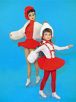 Barbie-type dolls in ice skating outfits