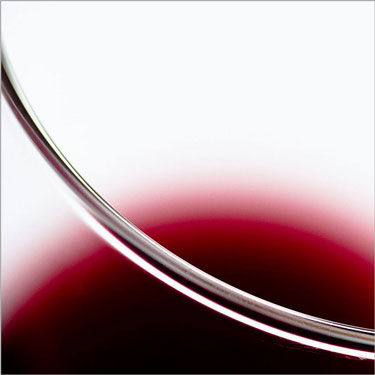 Abstract image of glass of red wine