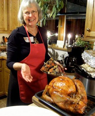 Judy Hand with freshly baked turkey, aka the Solstice bird